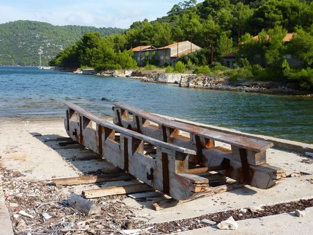 slipway: A wooden slipway in a bay in Croatia Stock Photo
