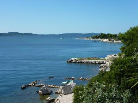 dikes: Dams of stones at the Croatian coast near Zadar Stock Photo