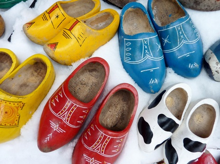 Painted wooden shoes in the snow photo