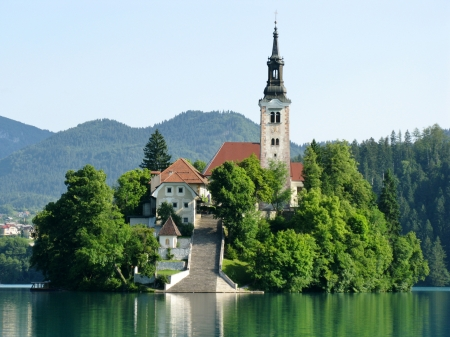 A church at the island in lake Bled in Slovenia photo