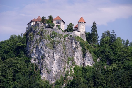 The castle at the cliff above lake Bled in Slovenia photo