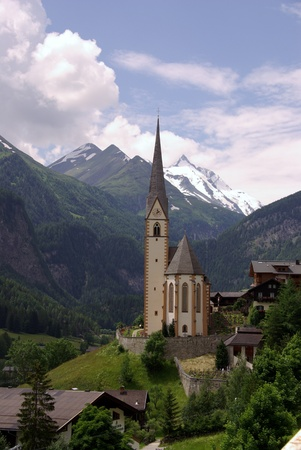 The gothic pilgrimage church of Saint Vincent in Heiligenblut in Austria photo
