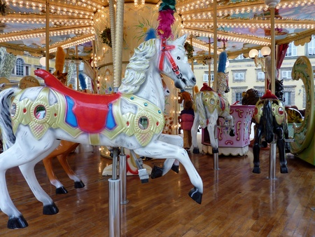 A horse at a merry-go-round photo