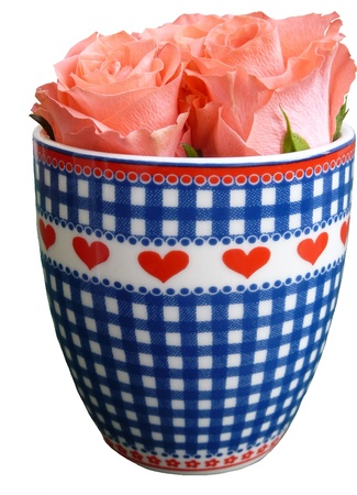 Roses in a cup with hearts photo
