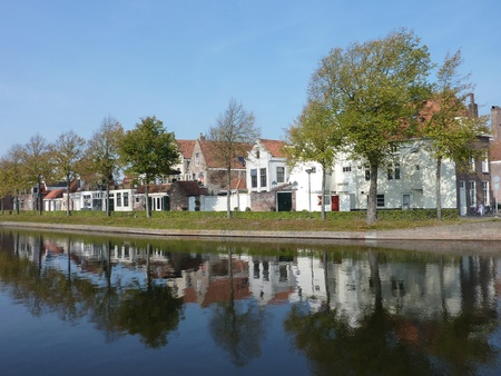 house gable: Houses in Middelburg in the Netherlands with reflections in a canal