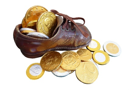 characterizing: Euro coins of chocolate in a children shoe Stock Photo