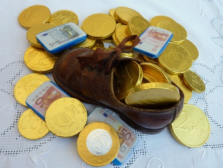 characterizing: Chocolate euro coins from Sinterklaas  in a children shoe