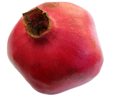 punica granatum: An isolated red pomegranate (punica granatum) fruit
