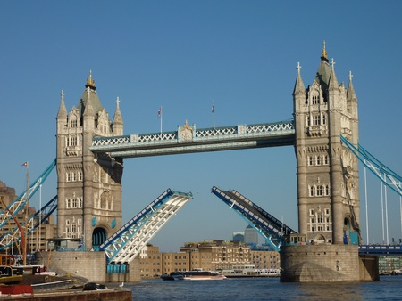 The open tower bridge over the river thames in London in England