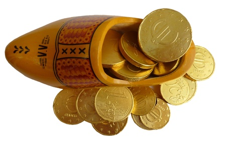 characterizing: The european euro crisis with euro coins of chocolate in a wooden shoe
