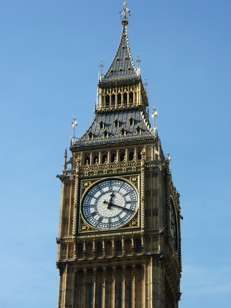 Big Ben the great bell of the clock tower of the palace of Westminster in London opposite a blue sky photo