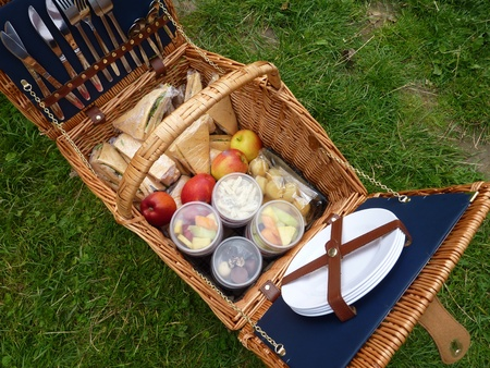 A picnic basket with the ingredients for a lunch in the open air photo