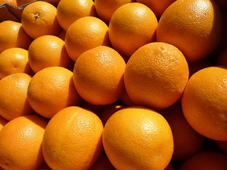 Oranges at the greengrocer on the marketplace photo