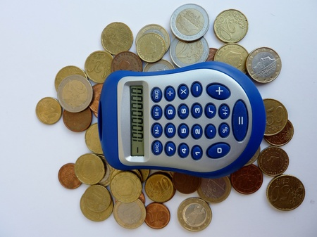 Euro coins and a calculator during the European credit crisis photo