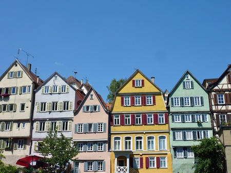 half  timbered: Half timbered houses in pastel colors at the Necktar in Tuebingen in Germany Stock Photo