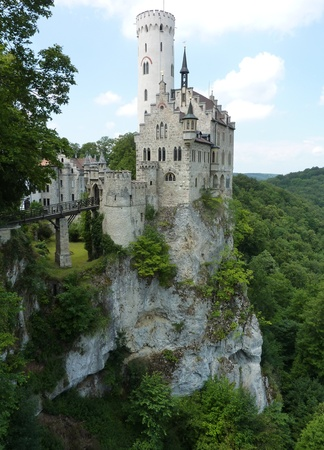 The fairy tale lichtenstein castle with its white watchtower in the Black Forest in Germany photo
