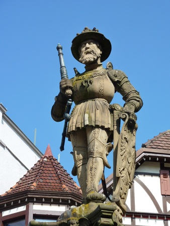 half  timbered: A historic statue of maximilian in the center of Reutlingen in Germany in front of half timbered houses
