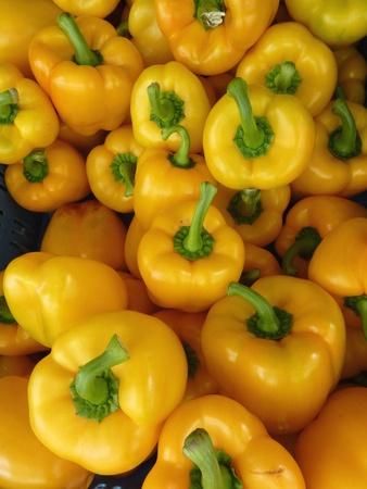 Yellow paparika fruits at the greengrocer Stock Photo