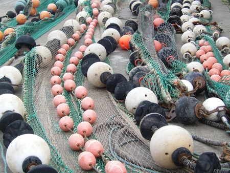 Floaters and fishermen nets Stock Photo - 11768681