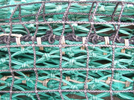 Green and grey nets used by the fishermen photo