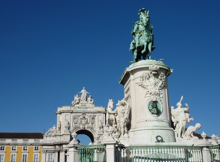 The rue Augusta arch and the statue of Sao Jorge in Lisbon in Portugal photo