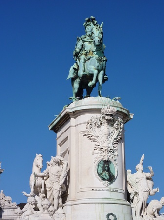 The statue of Sao Jorge on the praca do Comercio in Lisbon in Potugal photo