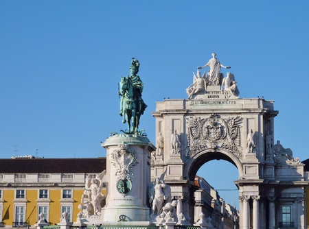 rue: The rue Augusta arch and the statue of Sao Jorge in Lisbon in Portugal