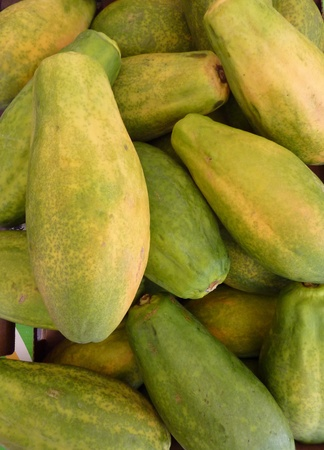 papaw: Fresh papaya fruits in a box at the greengrocer on the market place