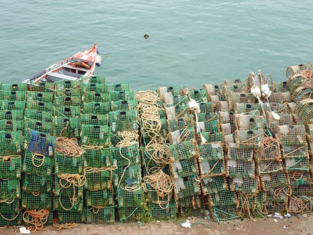 Basket fish traps in Cascais in Portugal to catch crab and lobster in the atlantic ocean photo