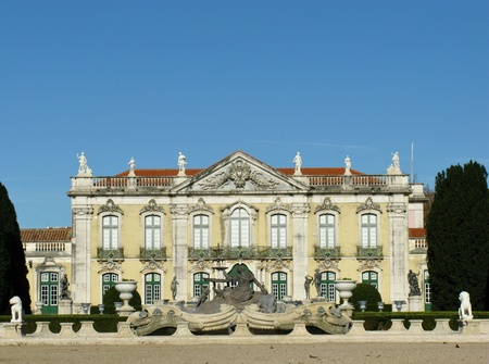 The ceremonial facade of the corps de logis of the Queluz national palace in Portugal with bronze statues in a fountain in front photo