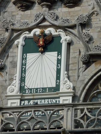 sun dial: The historic sun dial clock of the city hall of Middelburg in the Netherlands Stock Photo