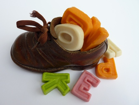 characterizing: A children shoe with characters of marzipan from Sinterklaas