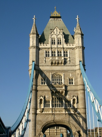 A detail of the historic tower bridge over the river thames in London in England photo