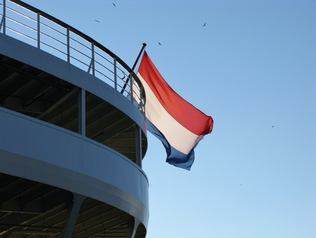 The Dutch flag the symbol for the Netherlands at the back of a ship photo