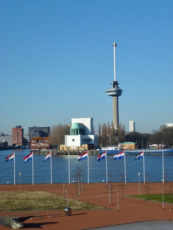 euromast: Euromast along the river Meuse in Rotterdam in the Netherlands with the Dutch national flag
