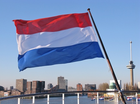 The Dutch flag the symbol for the Netherlands and the skyline of Rotterdam Stock Photo - 12186439