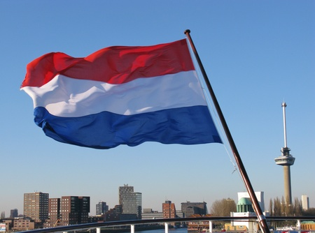 The Dutch flag the symbol for the Netherlands and the skyline of Rotterdam Stock Photo - 12186437