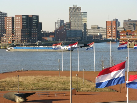Skyscrapers along the river Meuse in Rotterdam in the Netherlands with the Dutch national flag Stock Photo - 12186449