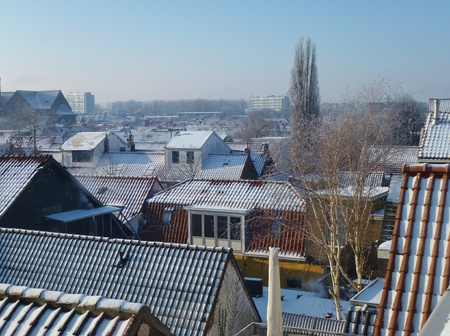 Roofs of houses in the city with snow in the winter Stock Photo - 12378161