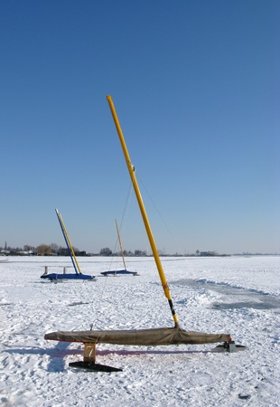 Ice sailing boats ready for a regatta on the frozen lake photo