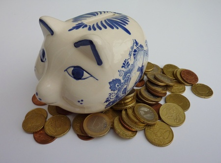 A delft blue piggy bank with euro coins photo