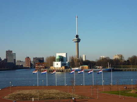 euromast: View at the river Meuse in Rotterdam with dutch flags in front