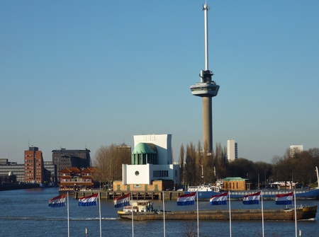 euromast: View at the river Meuse iun Rotterdam with dutch flags in front
