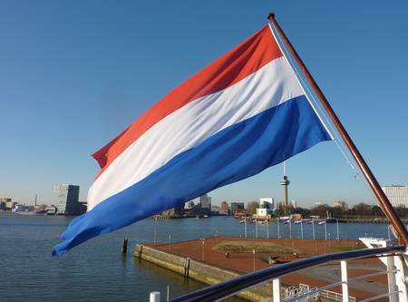 The Dutch flag on the back of a ship in the Meuse in Rotterdam Stock Photo - 12378166