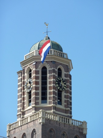 pepperbox: The tower of the our lady ascension basilica is called the peperbus (pepperbox) with the dutch flag in Zwolle in the Netherlands
