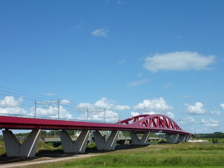 The new railroad and cycle bridge in perspective over the river IJssel in Zwolle in the Netherlands Stock Photo