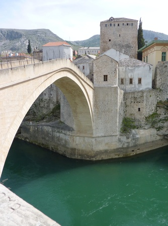 Stari Most the historic Turkish bridge over the river Neretva connecting the Muslim side of the city to the Catholics photo