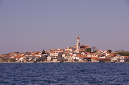 The village Betina at Murter in Croatia in evening light photo