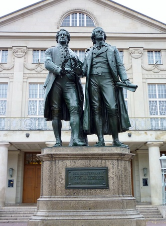 A statue of Goethe and Schiller in front of the German national theatre in Weimar in Germany