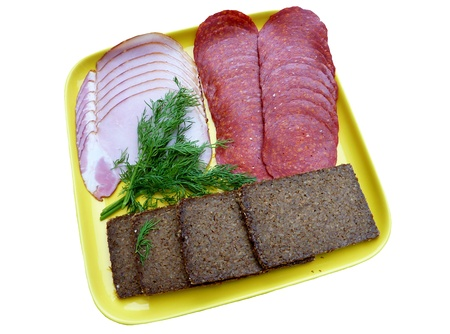 Cold cuts and rye bread at a yellow plate photo